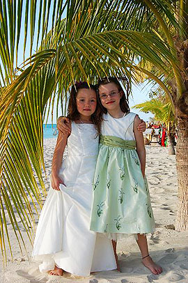 Charela Flower Girls Standing On Beach